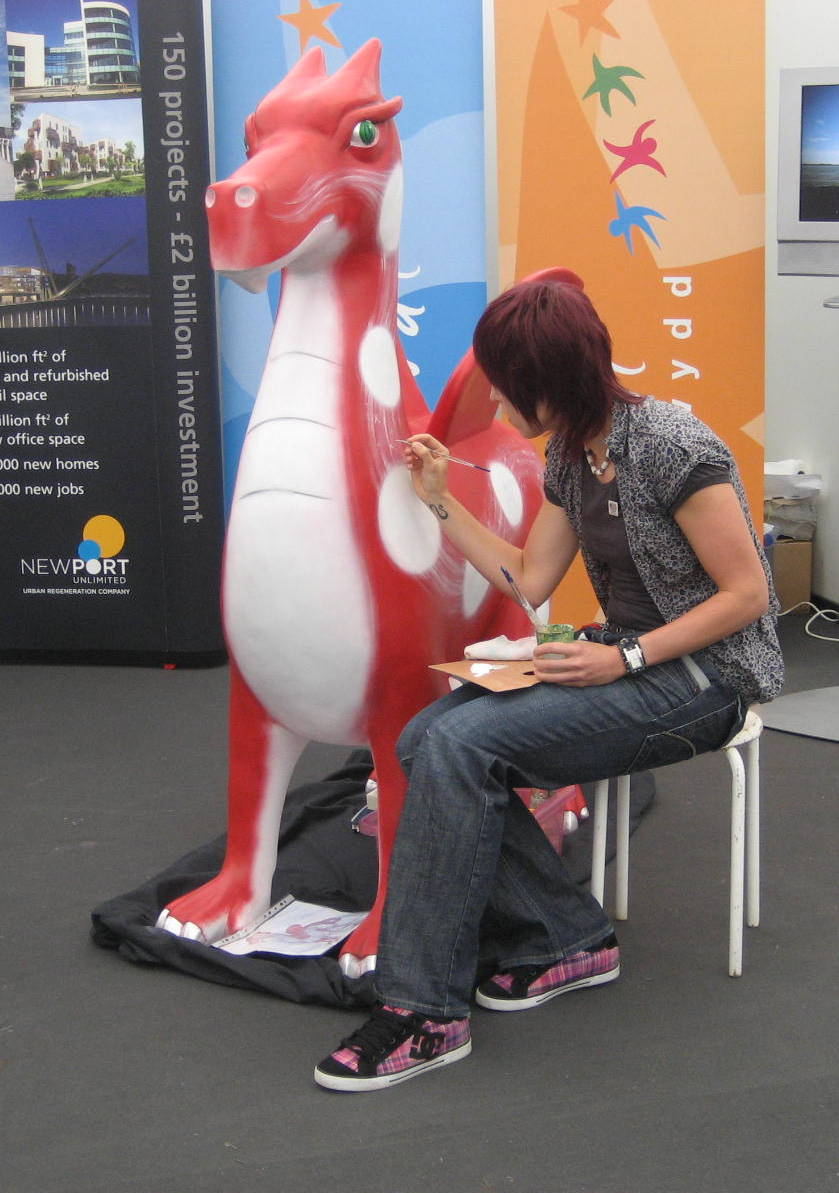 artist painting a Welsh dragon